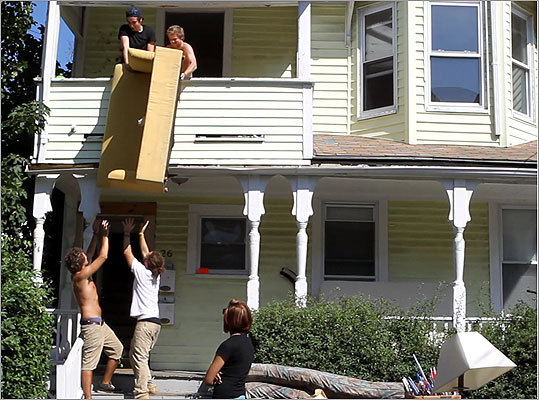Recent graduates from the Art Institute of Boston and Lesley College took an unconventional approach to getting a couch out of the second floor, while painters were inside getting the Allston apartment ready for the next tenant.