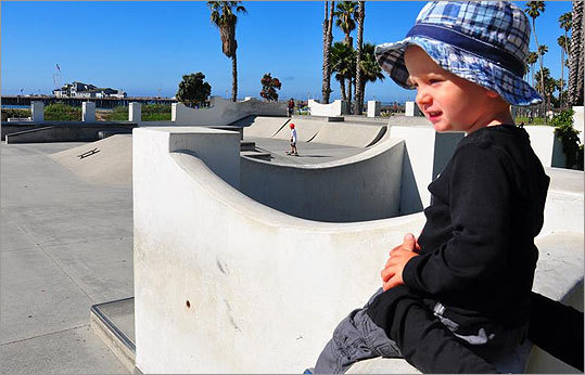 Charlie Blue Baker, about to turn 2, watched little boys skateboard in a skatepark on the beach in Santa Barbara.
