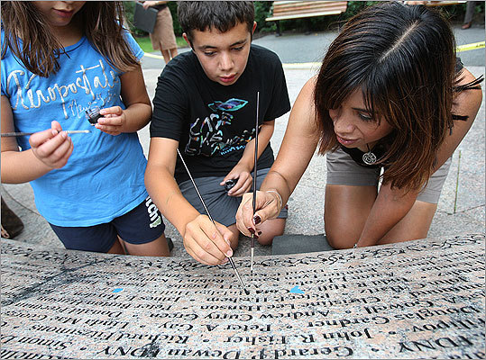 Holland brought her children, Drew, 12, and Amelia, 10, to a memorial at the Public Garden to re-etch the name of her mother.