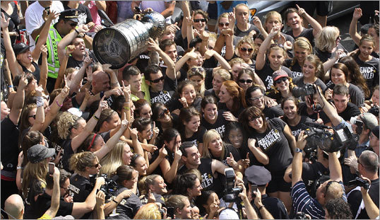 When Andrew Ference brought the cup to Hanover Street in the North End, a flash mob appeared.