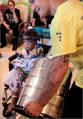 Bruins defenseman Andrew Ference had his day with the Stanley Cup on Sat. Sept. 5, and he spent part of it visiting patients like DeVontae Morrison, 3, at the Spaulding Rehabilitation Hospital in Boston.