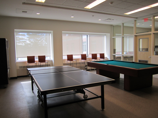 Next to the laundry room on the ground floor, a recreational space - furnished with ping-pong and pool tables - is available to students who inhabit the dorm. A large flat-screen television hovers over an eco-friendly 'hydration station' and vending machines for late-night study snacks.