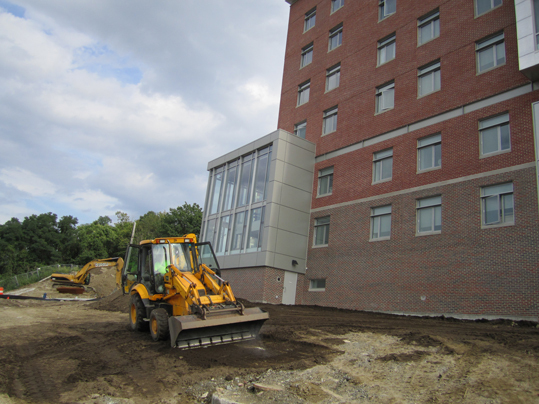 As school opens and new residents move in, construction workers still labor to finish the hall's outside aesthetics. When construction is finished, green grass will have replaced the dirt and sand that currently occupies the residence grounds.