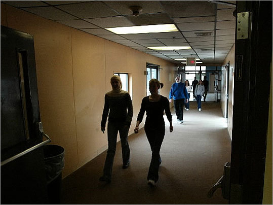 Plymouth Other towns are close on Norwood's heels. Plymouth North High School is under construction using model designs. At left, in 2003 students walked through poorly lit corridor that led to portable classrooms at the formerly aging and crowded Plymouth North High School.