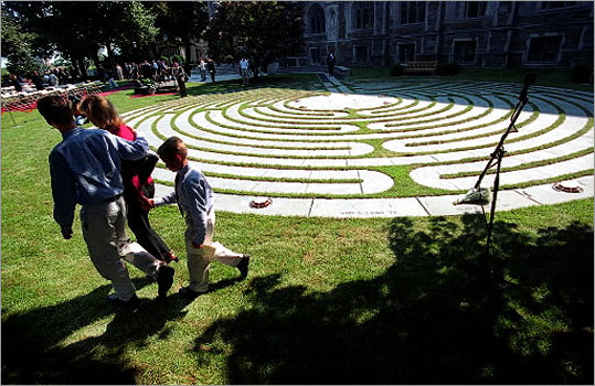 Boston College in Chestnut Hill paid tribute to its 22 alumni killed in the terrorist attacks of 9/11 with the dedication of a memorial stone labyrinth on the lawn of the Burns Library on Sept. 11, 2003. Family members of the victims attending the ceremony included Kathy Hallstrom of North Andover, who lost her brother Sean Lynch, a 1989 graduate of BC.