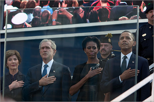Left to right: Laura Bush, Former President George Bush, first lady Michelle Obama, and President Barack Obama saluted at the 9/11 Memorial during ceremonies of the September 11, 2001 terrorist attacks in New York City.