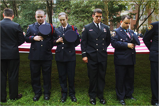 Firefighters observe a moment of silence at a memorial service for firefighters killed on the 10th anniversary of the terrorist attacks at the Firemen's Monument at Riverside Park in New York City.