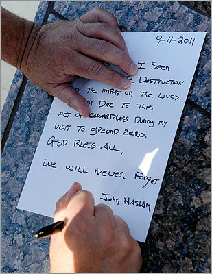 Weymouth, Mass. Fire Department Deputy Chief John Haslan wrote down his thoughts on the Sept. 11 attacks at the Tribute to Heroes of 9/11 display in Las Vegas.