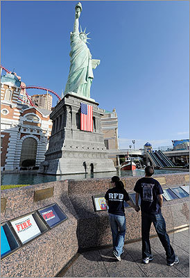 Jenna Kinsley and Patrick Kinsley walked by the Tribute to Heroes of 9/11 display in front of the half-size replica of the Statue of Liberty outside the New York-New York Hotel & Casino on Sunday in Las Vegas.