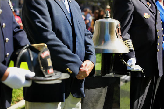 Chief Paul J. Zbikowski, president of the Fire Chiefs' Association of Massachusetts, Inc., rang the fire bell during the reading of 'The Last Alarm'.
