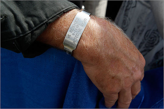 An attendee at the Flight 93 memorial wears a 'We Remember 9-11-01 United We Stand' bracelet during ceremonies marking the 10th anniversary of the 9/11 attacks on Shanksville, Penn. on Sunday.