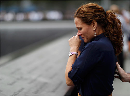 A mourner looks at names of lost loved ones during ceremonies marking the 10th anniversary of the 9/11 attacks on the World Trade Center in New York Sunday.