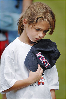 Brinlee McCluskey, 9 years old, bowed her head in prayer as the Rev. Steve Campbell of Pinelake Church in Flowood, Miss. offers an invocation outside Reservoir Fire Department Station 1. See images of ceremonies across the nation and world.