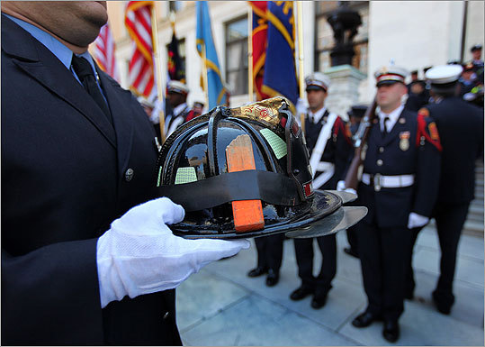 During the processional, 343 firefighters walked in holding their helmets, symbolizing the 343 firefighters killed in New York.