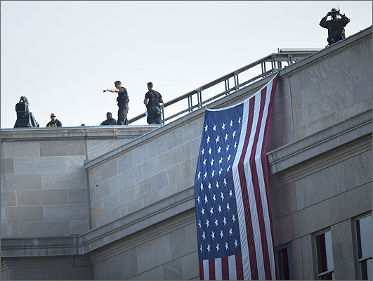 Members of the Secret Service counter sniper team and other security took positions on the roof before a memorial service at the Pentagon in Arlington, Virginia. Vice President Joe Biden, Secretary of Defense Leon E. Panetta, Chairman of the Joint Chief of Staff Navy Admiral Mike Mullen, and others will attend a memorial service at the Pentagon Memorial to commemorate the Sept. 11 attacks.