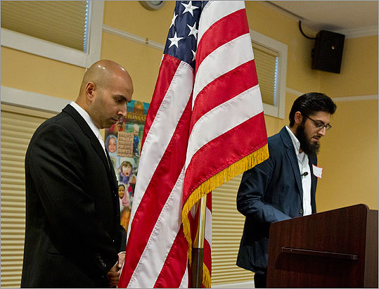 Muneeb Khan, left, secretary of the Islamic Center of Boston, listened as Bilal Mirza recited the Qur'an during the 10th Anniversary of the September 11th attacks.
