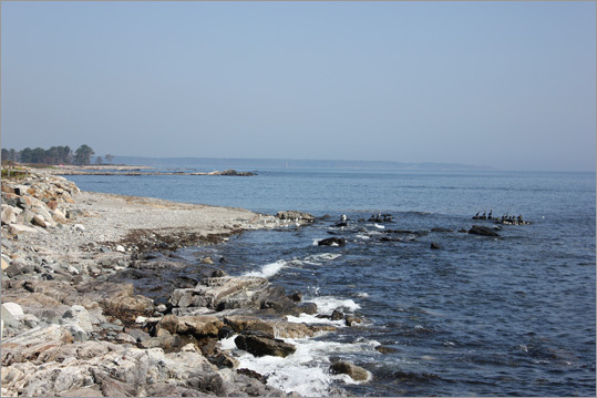 At left, a view of the rocky coast along a section of Route 1A just south of Odiorne State Park.
