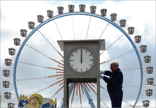 A man checked a clock at the Theresienwiese fairground.