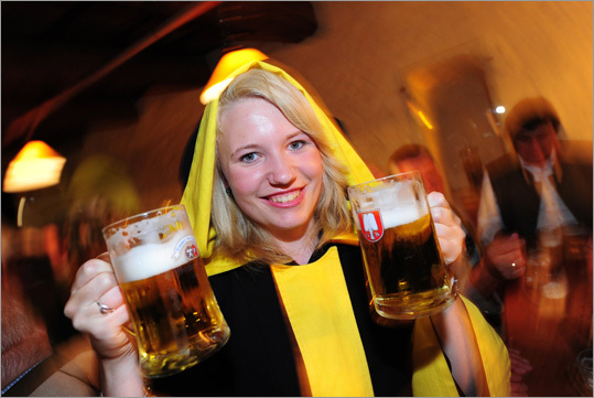 Maria Neffzeller, dressed as the Munich Kindl, the Bavarian city emblem figure, held beer mugs at the Beer and Oktoberfest Museum in Germany earlier this week. The 2011 edition of the world's largest beer festival opened Sept. 17 in Munich. Here's a look at some of the preparations that took place in the weeks leading up to the big event.