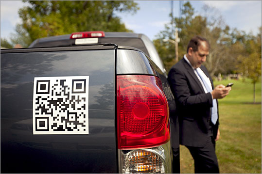 Realtor Gerry Bourgeois has a QR (quick response) code on the back of his car with the hopes that people might take a photo of his code with their smartphone.