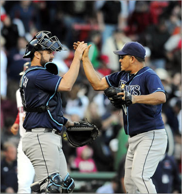 Relief pitcher Joel Peralta and catcher Kelly Shoppach celebrated after the Tampa Bay Rays won the final game of their four-game series against the Red Sox, 8-5. The Rays won three of four and cut the Red Sox lead to two games in the American League wild-card race.