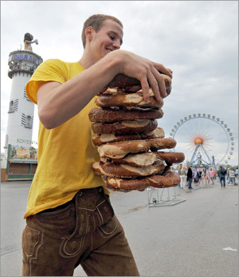 A man carried a stack of pretzels prior to the start of the festival.