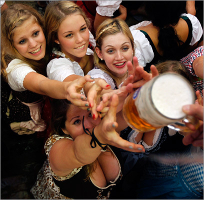 Women reached out for a beer in the Hofbraeuhaus tent.