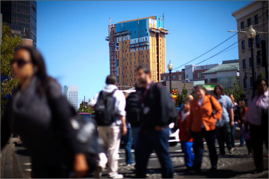 The new student residence tower , which is under construction, looms large over Huntington Avenue. With 21 stories, the building will add 145,000 square feet of dormitory and facility space to MassArt, the college said. The new building is expected to open in the fall of 2012, the college said.