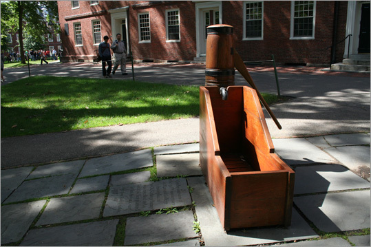 Correct answer: The bottom of the old water pump in Harvard Yard