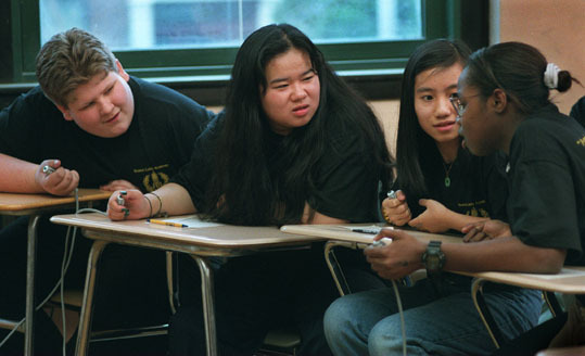 English: Boston Latin Academy The Academy also placed high on the list. Boston Latin Academy students Mike Clark, Viet Luong, Hang Do, and Farlita Zelee debate the answer to a question posed to their team at a competition.