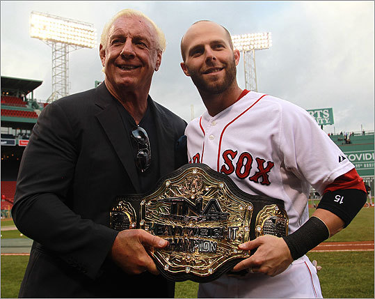 Pro wrestler Ric Flair met up with Red Sox second baseman Dustin Pedroia, a huge fan, prior to the start of Tuesday night's game against the Orioles at Fenway.