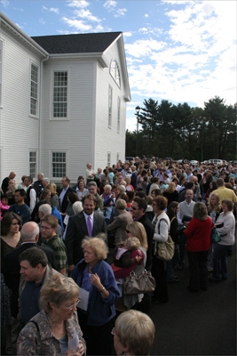 Hundreds of people gathered outside the church on opening day to experience the first service in the new building.