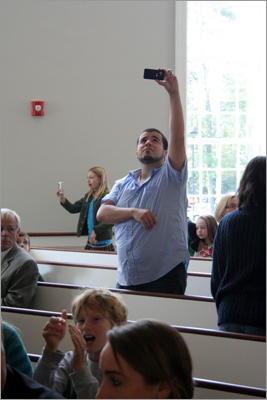 One worshiper takes out his camera to snap a picture of the new space.