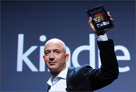 Size The Kindle Fire will have a 7-inch, 16-million color display, which is about half the size of the iPad and a close match to the Barnes and Noble Nook Color tablet. It weighs 14.6 ounces. Left: Amazon chief executive Jeff Bezos held the Fire during its launch announcement.