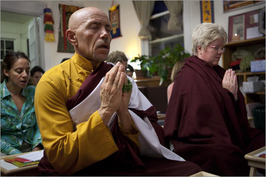 Now the meditation center is raising money for a permanent home, which is a requirement for the statue to be consecrated. The center has raised $70,000 toward a new building, which leaders want to keep near a bus line in the Arlington or Cambridge area. They hope to raise $100,000 for a down payment. Paul Orr (on left) and Dorothy Spoor (right) meditate.