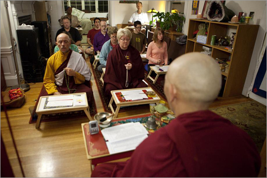 "''The purpose of the statue was to bring a spiritual object to the United States that would benefit the whole Boston area and the whole US, said Alexis Tsapatsaris, president of the meditation center, ""and also to give people who didn't have access to going to Tibet a spiritual object here."" Khenpo Choepel Rinpoche leads practitioners at the meditation center."