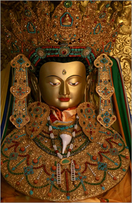 Buddhists believe the original statue, 2,500 years old, gives blessings to pilgrims who travel to look upon it. A closeup of the face of the Jowo Rimpoche.