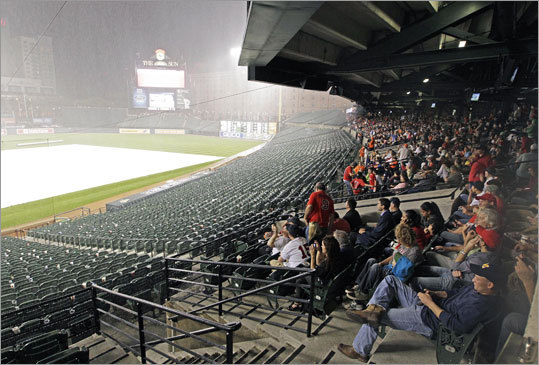 The game was delayed by rain in the seventh inning. It resumed at 11 p.m.