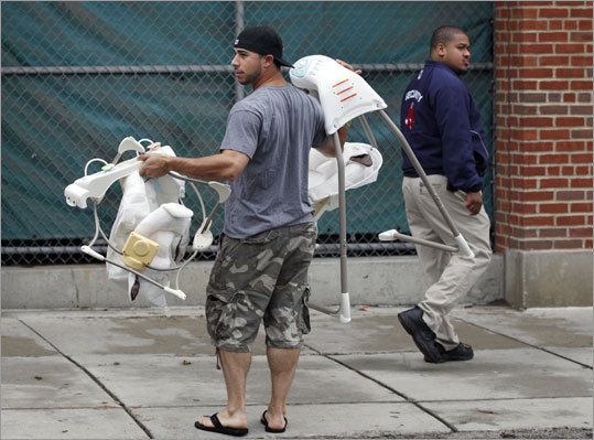 Red Sox infielder Mike Aviles carried baby seats into the clubhouse at Fenway Park.