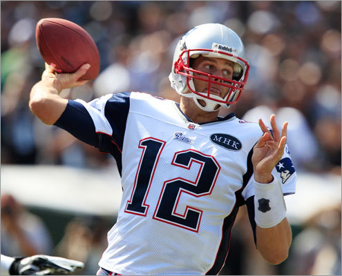 Patriots quarterback Tom Brady dropped back to pass in the first quarter of Sunday's game against the Raiders in Oakland. Both teams entered the game with 2-1 records.