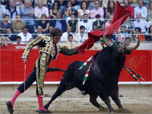 Spanish bullfighter Jose Tomas performs a pass during the last bullfight at Monumental bullring in central Barcelona on Sept. 25.