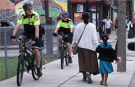 Boston Police Officers Pat Flaherty and Stephanie O'Sullivan patrolled Bowdoin Street in Dorchester on bicycles.