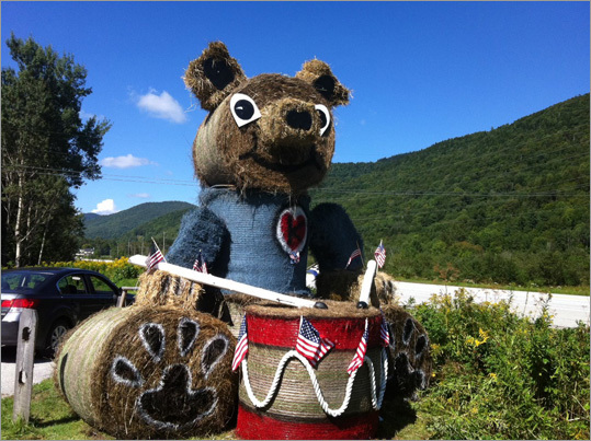 At left, the 'Drummer Bear,' one of the 40 hay structures featured at Killington-area businesses.