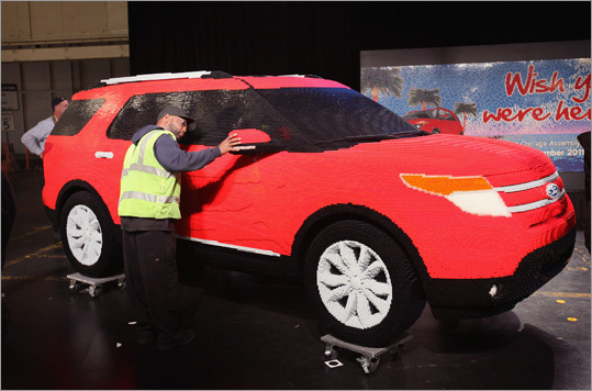 Ford employee Colan Williams looked over a Ford Explorer Legoland Florida 'edition' made from Lego bricks. The Lego Explorer, which was built using 382,858 Legos, was scheduled to be displayed at the theme park.