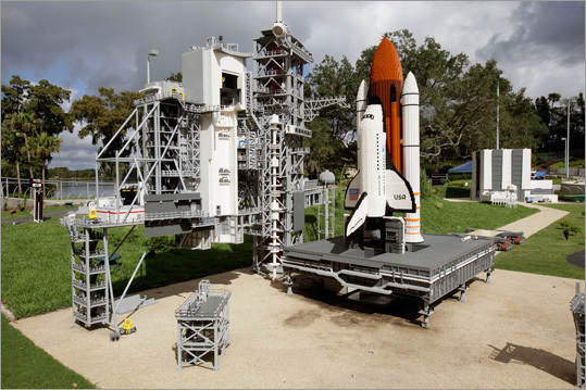 A Lego model of the space shuttle and launch pad.