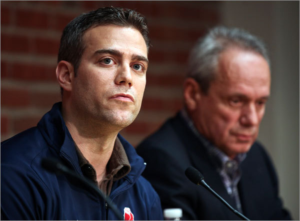 Red Sox general manager Theo Epstein (left) and President/CEO Larry Lucchino speak during a press conference at Fenway Park on Friday.