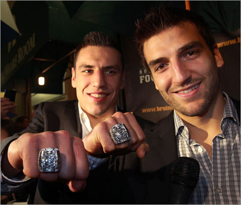Milan Lucic (left) and Patrice Bergeron showed off their Stanley Cup championship rings at a special team dinner at the Boston Harbor Hotel. The players and team management had a red-carpet entrance prior to the dinner, at which the ring design was revealed and each player who participated in the Stanley Cup playoffs and final was presented with a ring.