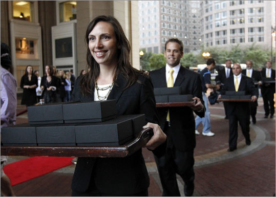 Representatives of the ring manufacturer, Jostens, transported the ring boxes from an armored vehicle into the Boston Harbor Hotel.