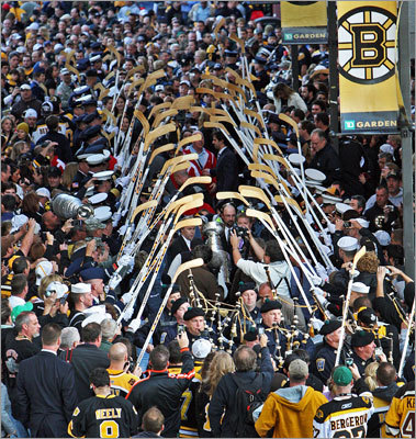 The Stanley Cup was carried under crossed hockey sticks behind TD Garden as it made its way into the building.