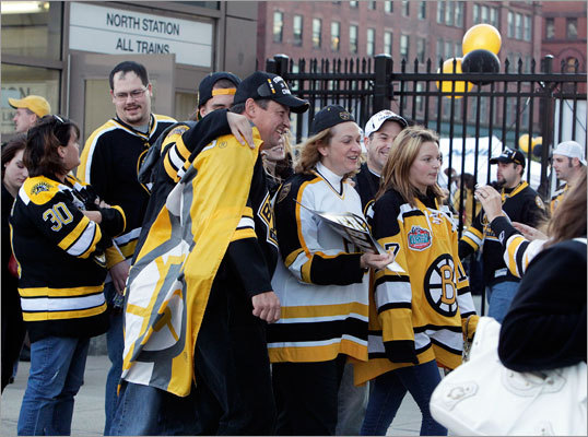 Fans decked out in Bruins gear posed for pictures outside of North Station.